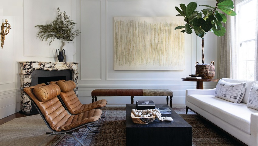 """One of my first inspirations for the project was a photo of fashion blogger Chriselle Lim leaning up against a fireplace in a beautiful salon in Paris,"" says homeowner Tracy Falconer of the formal living room that features vintage Arne Norell lounge chairs from the 1970s and a bench from Nickey Kehoe in L.A. ""Bamboo Curtain"" by Stephen Foss hangs besides the honed Paonazzo marble fireplace, fabricated by Chesney's. PHOTOGRAPHED BY BESS FRIDAY"